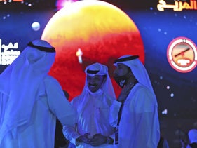Emiratis talking ahead of the live broadcast of the Hope Probe entering Mars orbit