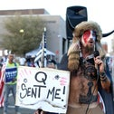 A QAnon believer at a pro-Trump rally, in November.