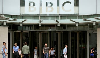 People arrive and depart from Broadcasting House, the headquarters of the BBC, in London, Britain, 2015.