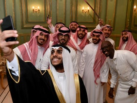 Saudi men pose for a selfie