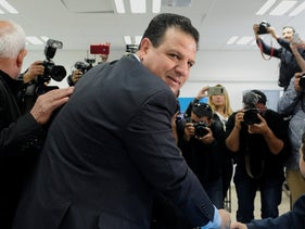 Joint List Chairman Ayman Odeh votes in Israel's March 2020 election, last year.