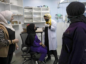 A nurse administers the COVID-19 vaccine to a Palestinian at the Al-Mezan Hospital in Hebron, West Bank, yesterday