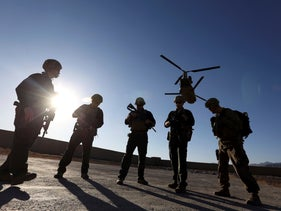 American soldiers wait on the tarmac in Logar province, Afghanistan, four years ago.