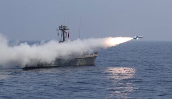 A missile is launched by Iran's military during a navy exercise in the Gulf of Oman