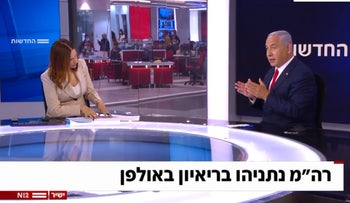 Yonit Levi interviews Netanyahu for Channel 12 News, yesterday.