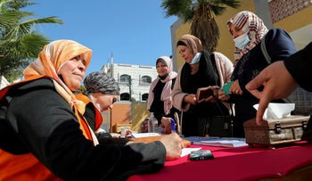 Palestinians women register for elections in Gaza City, today.