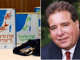The legendary Jewish National Fund blue collection boxes and JNF-USA CEO Russell Robinson.