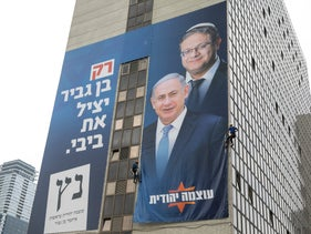 "Otzma Yehudit's campaign poster showing Itamar Ben-Gvir (top) and Benjamin Netanyahu. The poster says: ""Only Ben-Gvir will save Bibi."""