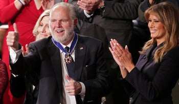 Conservative radio talk show host Rush Limbaugh reacts as he is awarded the Presidential Medal of Freedom in Washington.