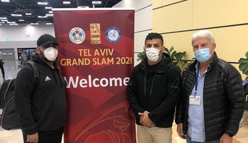 Iranian judo star Saeid Mollaei, center, after landing at Ben-Gurion Airport this week.