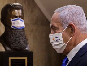 Israeli Prime Minister Benjamin Netanyahu in Jerusalem this week, while a mask-clad bust is seen of Theodor Herzl, the founder of modern Zionism