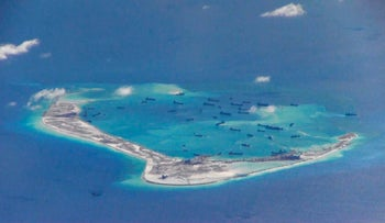 Chinese dredging vessels are purportedly seen in the waters around Mischief Reef in the disputed Spratly Islands in the South China Sea, in 2015.
