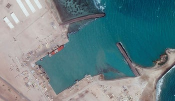 Satellite photo from Planet Labs Inc. shows an empty port at an Emirati military base in Assab, Eritrea