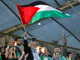 Gaza's top Hamas leader, Ismail Haniyeh, waves Palestinian flag at a 'victory' rally at the end of the 2014 Gaza-Israel war, a conflict now under ICC investigation