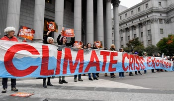 Climate activists protest on the first day of the Exxon Mobil trial outside the New York State Supreme Court building, 2019.