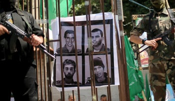 A picture of two Israeli soldiers killed in action, and two Israeli civilians kept in captivity in Gaza, on Prisoners' Day in 2016.