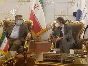 The IAEA's Rafael Mariano Grossi, right, meeting with spokesman of Iran's atomic agency Behrouz Kamalvandi at Tehran's Imam Khomeini airport, on Saturday.