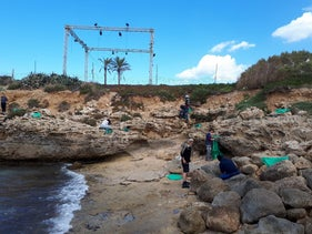 Israelis cleaning a beach at a kibbutz after an oil spill in the Mediterranean Sea, yesterday