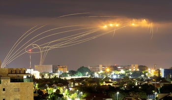 Israel's Iron Dome system, developed by Rafael Advanced Defense Systems and Israel Aerospace Industries, intercepts rockets fired from Gaza Strip