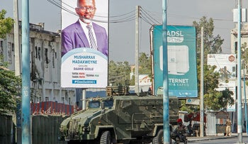 Security forces block a street with an armored personnel carrier during protests against the government and the delay of the country's election in the capital Mogadishu, Somalia Friday