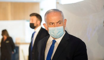 Netanyahu presenting the 'green passport' application for vaccinated Israelis earlier this month.