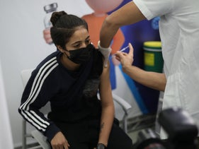 A patient receives a coronavirus vaccine at a vaccination station for youth in Holon, last week.