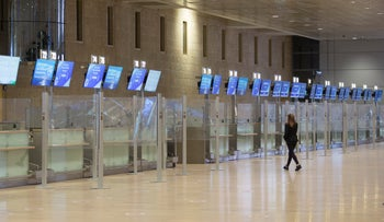 A staff member walks through Ben Gurion Airport's empty departure hall, last month.