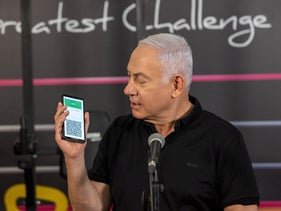 Prime Minister Benjamin Netanyahu presents Israel's 'Green Passport' this week. The app and website certifying vaccination against coronavirus has been plagued with bugs and security issues