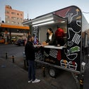 A Palestinian university graduate sells French fries in a food truck in Ramallah, last month.