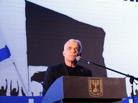 Yair Lapid speaks at an anti-Netanyahu rally in Tel Aviv last year.