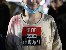 'Danger! Here comes a dictatorship.' An anti-vaccination protester in Tel Aviv last week.