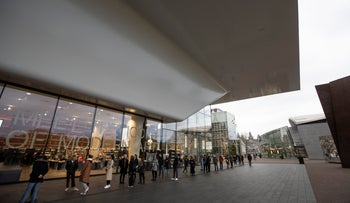 Visitors queue to enter Stedelijk Museum in Amsterdam, last year.