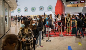 Israelis queue to buy costumes ahead of the Jewish holiday of Purim in Dizengoff Center in Tel Aviv, yesterday.