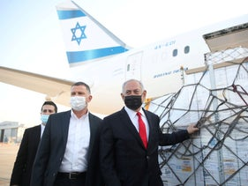 Netanyahu next to a shipment of Pfizer vaccines at Ben-Gurion International Airpor, last month.