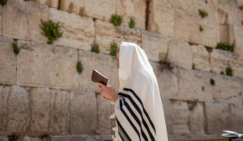 A man praying at the Western Wall in Jerusalem, widely regarded as Judaism's holiest site
