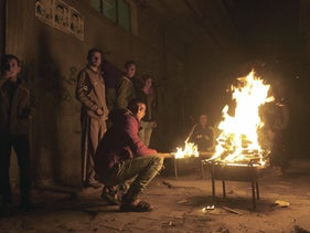 Palestinians gather around a fire during a power cut in the Al-Shati refugee camp in Gaza City in 2017.