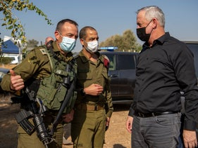Defense Minister Benny Gantz speaks with IDF officers during a military exercise in the north, in October.
