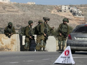 IDF soldiers man a checkpoint near Nablus.