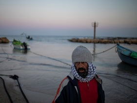 A local fisherman who goes by the name Jumbo returns from a fishing trip on the Mediterranean Sea, in the Israeli Arab village of Jisr al-Zarqa, Israel, early this morning.