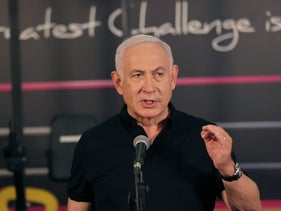Israeli Prime Minister Benjamin Netanyahu talks to the media during a visit to the Fitness gym in Petah Tikva.