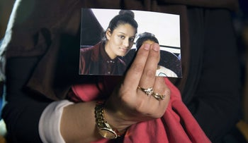 Renu, sister of Shamima Begum, holds a picture of her sister during an interview, London, February 22, 2015.