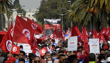 Supporters of the Islamist Ennahdha party wave flags during a demonstration in support of the Tunisian government in Tunis today