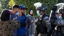Palestinians argue with Israeli security forces as they prepare to demolish the house of Palestinian Mohammed Qabaha, Jenin.