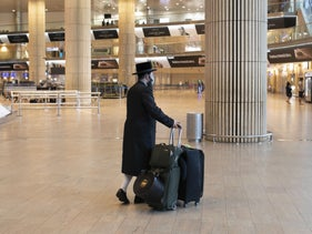 An ultra-Orthodox traveler in the arrivals hall at Ben-Gurion Airport last year.