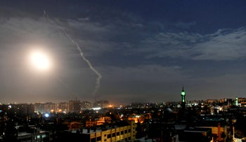 Missiles flying into the sky in Damascus near its international airport, two years ago.