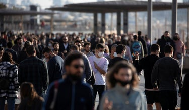 People walk by the beach in Tel Aviv as lockdown restrictions are eased, last month.