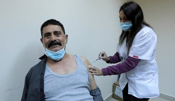 A man receiving a COVID-19 vaccine in the southern city of Rahat