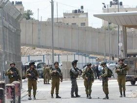 Israeli soldiers at the Qalandia checkpoint, a main crossing point between Jerusalem and Ramallah, in 2016.