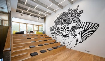 A black and white wall mural by street artist Pilpeled at the newly renovated Beit Ariela Public Library and Cultural Center.