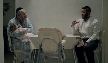 """Dovale Glickman, left, and Michael Aloni in a scene from Season 3 of """"Shtisel."""" (Courtesy of Yes Studios)"""